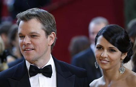 Matt Damon, best supporting actor nominee for ''Invictus'' and his wife, Luciana Barroso, arrive at the 82nd Academy Awards in Hollywood, March 7, 2010. REUTERS/Lucas Jackson