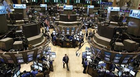 Traders work on the floor of the New York Stock Exchange, January 11 ...