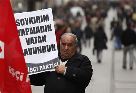 A Workers Party supporter holds a placard that reads: ''We did not genocide, defended homeland'' during a protest near the Swedish consulate in Istanbul March 12, 2010. REUTERS/Murad Sezer