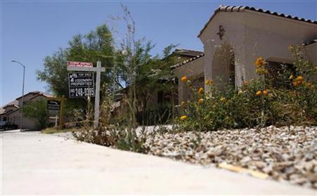 Real estate signs are seen in the front yards of houses for sale in this file photo taken in Maricopa, Arizona, May 27, 2009. REUTERS/Joshua Lott/Files