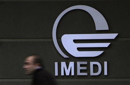 A man passes by a logo of Imedi TV station in Tbilisi March 15, 2010. REUTERS/David Mdzinarishvili