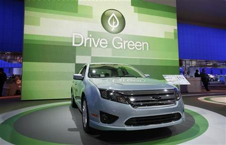 The 2010 Ford Fusion is seen in front of a sign that reads ''Drive Green'' at the 2010 North American International Auto Show during press days in Detroit, Michigan January 11, 2010. REUTERS/Mark Blinch