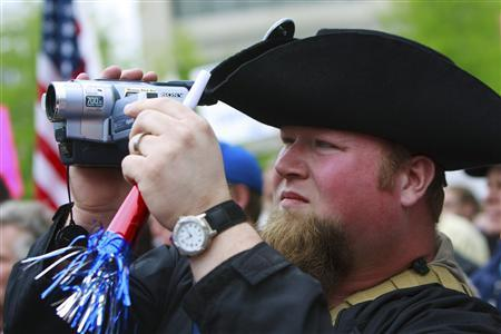 Phillip Smith of Bedford County, Tennessee, takes part in a rally at the Tennessee State Capitol at the Tax Day Tea Party in downtown Nashville, Tennessee, in this April 15, 2009 file photo. REUTERS/Harrison McClary/Files