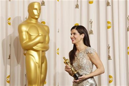 Actress Sandra Bullock smiles with her best actress Oscar after winning for her role in ''The Blind Side'' backstage at the 82nd Academy Awards in Hollywood March 7, 2010. REUTERS/Lucy Nicholson