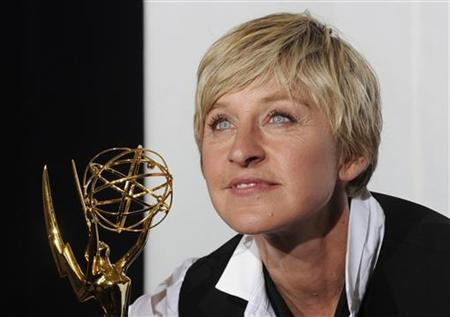 Ellen Degeneres poses with her award for Outstanding Talk Show Host at the 35th Annual Daytime Emmy Awards at the Kodak theatre in Hollywood, California June 20, 2008. REUTERS/Phil McCarten