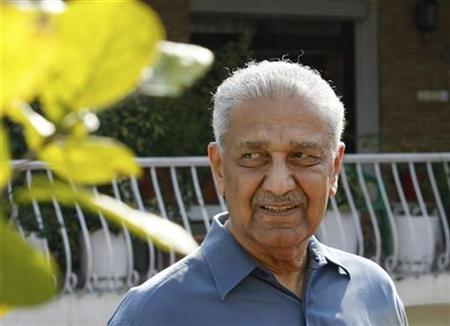 Nuclear scientist Abdul Qadeer Khan smiles at the media after his court verdict outside his residence in Islamabad February 6, 2009. REUTERS/Mian Khursheed