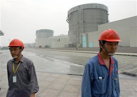 Chinese workers leave the nuclear power plant in Qinshan, China's Zhejiang province in this June 10, 2005 file picture. REUTERS/Reinhard Krause/Files