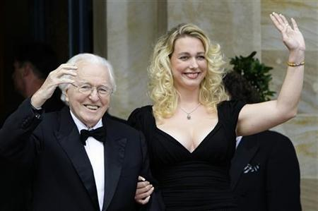 Wolfgang Wagner and his daughter Katharina wave after their arrival for the opening of this year's Bayreuth Wagner opera festival outside the so-called Gruener Huegel (Green Hill) opera house in Bayreuth, July 25, 2008. REUTERS/Michaela Rehle