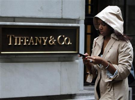 A woman walks past the Tiffany & Co. store on Wall St. in New York's financial district, March 22, 2010. REUTERS/Brendan McDermid