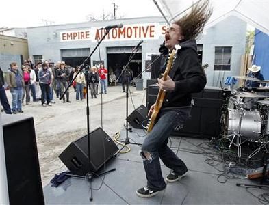 J Roddy Walston and The Business of Baltimore, Maryland perform at the 40 Watt Club day party in the Empire Automotive Service lot during the South by Southwest 2010 Music Conference in Austin, Texas March 20, 2010. Nearly 2,000 artists from over 40 countries played in the music portion of South by Southwest, also dubbed as SXSW, that ran through March 21, 2010, up about 100 from last year. REUTERS/Erich Schlegel