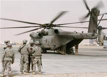 <p>U.S. soldiers prepare to fly while standing next to a CH-53 helicopter in Camp Bastion, Helmand Province, March 22, 2010. REUTERS/Asmaa Waguih</p>