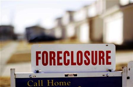 The sign for a foreclosed house in Denver, March 4, 2009. REUTERS/Rick Wilking