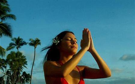 A woman meditates in a file photo. REUTERS/File