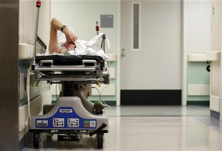 A patient waits in the hallway for a room to open up in the emergency room in Houston, Texas, July 27, 2009. REUTERS/Jessica Rinaldi