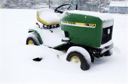 A John Deere riding lawn mower sits covered in snow in Port Washington, New York, February 26, 2010. REUTERS/Shannon Stapleton