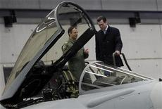 <p>German Defence Minister Karl-Theodor zu Guttenberg looks at a Eurofighter jet plane during his visit at the Bundeswehr Fighter Squadron 74 in Neuburg January 11, 2010. REUTERS/Michael Dalder</p>