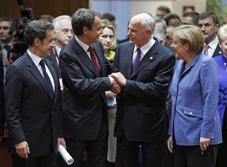 Spanish Prime Minister Jose Luis Rodriguez Zapatero (2nd L) shakes hands with Greek Prime Minister George Papandreou (2nd R) as German Chancellor Angela Merkel (R) and French President Nicolas Sarkozy look on at the start of a European Union leaders summit in Brussels March 25, 2010. REUTERS/Yves Herman
