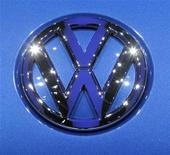 <p>The Volkswagen logo is displayed during the second media day of the 80th Geneva Car Show at the Palexpo in Geneva March 3, 2010. REUTERS/Denis Balibouse</p>