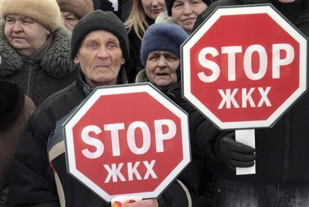 People stand with posters in the shape of a road sign during a protest in Russia's northern city of Arkhangelsk March 28, 2010. REUTERS/Alexei Lipnitsky