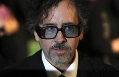 "<p>Director Tim Burton poses for photographers as he arrives for the Royal World Premiere of ""Alice In Wonderland"" at Leicester Square in London February 25, 2010. REUTERS/Jas Lehal</p>"
