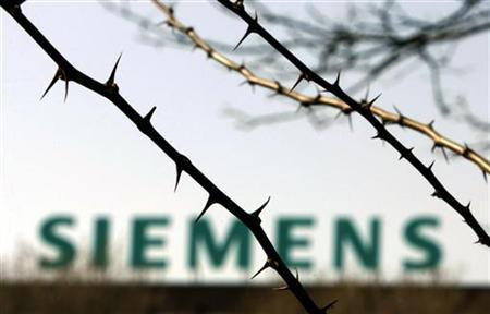 The logo of Siemens company is pictured in front of a factory in Berlin in this March 28, 2007 file photo. REUTERS/Tobias Schwarz/Files