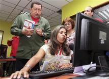 "<p>Venezuelan President Hugo Chavez presides over the official opening of a public internet venue named ""Infocentro"" during his weekly ""Alo Presidente"" broadcast in Caracas in this March 21, 2010 file photo. REUTERS/Miraflores Palace/Handout</p>"