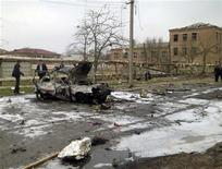 <p>Место взрыва в Кизляре 31 марта 2010 года. March 31, 2010. Около 10 человек, в основном, сотрудники правоохранительных органов, погибли в результате двух взрывов в дагестанском городе Кизляр на юге России. REUTERS/NewsTeam/Zaur Halikov</p>