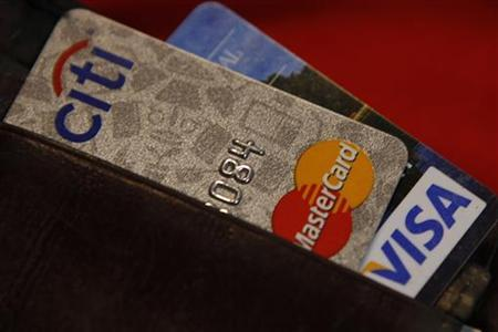 Credit cards are pictured in a wallet in Washington, February 21, 2010. REUTERS/Stelios Varias