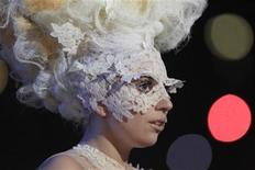 <p>Lady Gaga accepts the award for best international breakthrough act at the 30th Brit Awards ceremony at Earl's Court in London, February 16, 2010. REUTERS/Suzanne Plunkett</p>