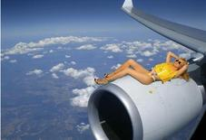 <p>A flight attendant posing nude in a calendar picture is seen in this handout released March 31, 2010. REUTERS/Augusto Robert/Handout</p>