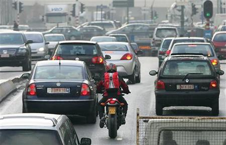 Cars drive along a road in central Brussels February 7, 2007. REUTERS/Yves Herman