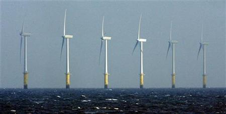 Wind Turbines stand in the Irish Sea at the North Hoyle offshore wind farm near Prestatyn, North Wales April 17, 2006. REUTERS/Phil Noble