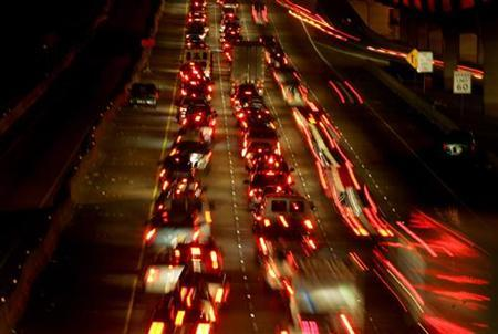Traffic lines a highway to Dallas in advance of Hurricane Rita in north Houston September 22, 2005.REUTERS/Carlos Barria