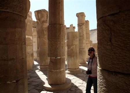 A tourist examines Queen Hatshepsut Temple in Luxor, southern Egypt, November 9, 2009. REUTERS/Goran Tomasevic