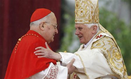Pope Benedict XVI embraces Italian cardinal Angelo Sodano as he leads the Easter mass in Saint Peter's Square at the Vatican April 4, 2010. REUTERS/Max Rossi