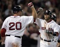 <p>Boston Red Sox Kevin Youkilis (20) congratulates teammate Dustin Pedroia on a two-run home run against the New York Yankees during the seventh inning of the first American League baseball game of MLB's 2010 season at Fenway Park in Boston, Massachusetts April 4, 2010. REUTERS/Adam Hunger</p>
