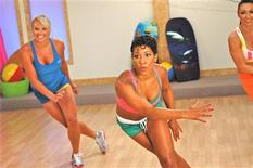 <p>Jeanette Jenkins, creator of Bikini Bootcamp DVD, and class demonstrate the skate exercise in Van Nuys, California, April 2009. REUTERS/Ali Vossough/Handout</p>