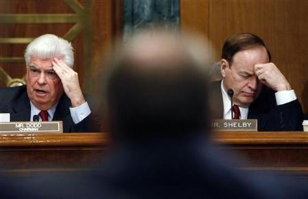 Christopher Dodd (D-CT), (L), chairman of the U.S. Senate Banking Committee and Senator Richard Shelby (R-AL) listen to testimony from the leaders of the big Detroit automakers during hearing on a financial assistance package for the companies on Capitol Hill in Washington, December 4, 2008 file photo. REUTERS/Joshua Roberts