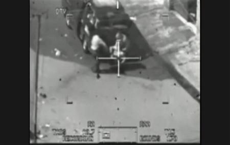 This image captured from a classified U.S. military video footage shows a wounded Iraqi person being loaded onto a van during a 2007 attack by Apache helicopters that killed a dozen people in Baghdad, including two Reuters news staff on July 12, 2007, and released to Reuters on April 5, 2010 by WikiLeaks, a group that promotes leaking to fight government and corporate corruption. REUTERS/WikiLeaks/Handout
