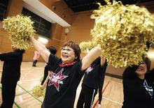 "<p>Fumie Takino, a 78-year-old cheerleader, practices cheerleading with other members of a seniors' cheerleading group called ""Japan Pom Pom"" in Tokyo March 24, 2010. REUTERS/Yuriko Nakao</p>"