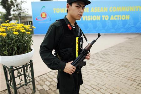 A member of Vietnam's security force guards the venue of the 16th ASEAN Summit in Hanoi April 6, 2010. REUTERS/Damir Sagolj