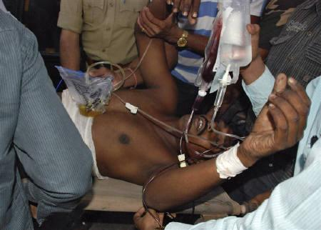 A policeman, who was wounded in a Maoist attack, is rushed to a hospital in Bauipariguda village in Orissa April 6, 2010. REUTERS/Stringer