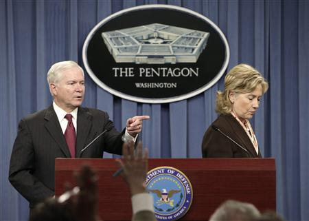 Secretary of Defense Robert Gates fields a journalist's question during a joint news briefing with Secretary of State Hillary Clinton on the new Nuclear Posture Review at the Pentagon, April 6, 2010. REUTERS/Yuri Gripas