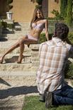 "<p>Photographer Eric LaCour photographs model Cassandra in the reality competition series ""Playboy Shootout"" shown in this undated publicity photo released to Reuters April 6, 2010. REUTERS/Playboy/Handout</p>"