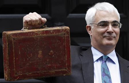Chancellor of the Exchequer Alistair Darling holds Gladstone's old Budget box for the cameras outside 11 Downing Street, before delivering the annual Budget to the House of Commons in central London March 24, 2010. REUTERS/Stefan Wermuth