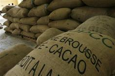 <p>Cocoa bags are seen in a warehouse in Gonate, western Ivory Coast, September 22, 2008. REUTERS/Luc Gnago</p>