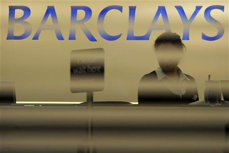A worker waits for customers in a branch of Barclays bank in London February 16, 2010. REUTERS/Jas Lehal