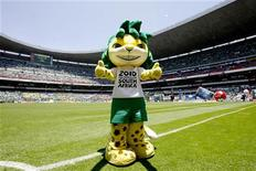 <p>Zakumi, the FIFA World Cup 2010 official mascot, poses before the CONCACAF qualifier soccer match between Mexico and the U.S. for the South Africa 2010 World Cup at the Azteca stadium in Mexico City August 12, 2009. REUTERS/Henry Romero</p>