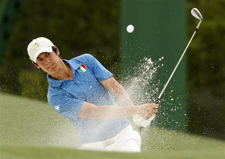 Matteo Manassero of Italy hits from a sand trap on the 18th green during first round play in the 2010 Masters golf tournament at the Augusta National Golf Club in Augusta, Georgia, April 8, 2010. REUTERS/Hans Deryk