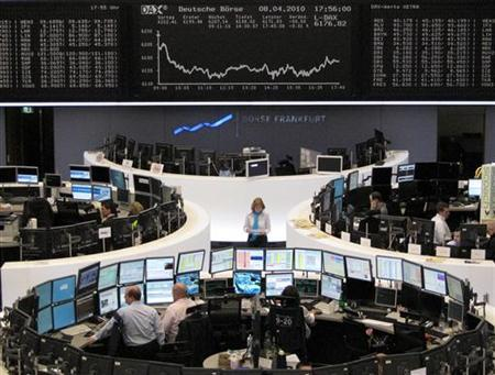 Traders are pictured at their desks in front of the DAX board at the Frankfurt stock exchange April 8, 2010. REUTERS/Remote/Amanda Andersen
